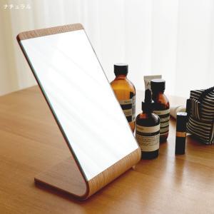 木目のカーブが綺麗な卓上ミラー。シンプルだけど少し変わった形で、お部屋に上品な雰囲気を演出します。 ...