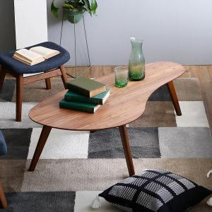 特徴的な変形デザインの木製センターテーブル  【サイズ】 幅120x奥行60x高さ38cm  【素材...