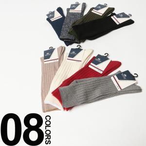 ビジネススタイルの足元をカラーで楽しむ、シンプルなクルー丈ソックス。リブ編みなのでフィット感があり、...
