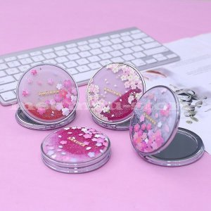 コンパクトミラー 手鏡 桜 ラウンドミラー 薄型 丸型 円形 携帯鏡 キラキラ グリッター かわいい...