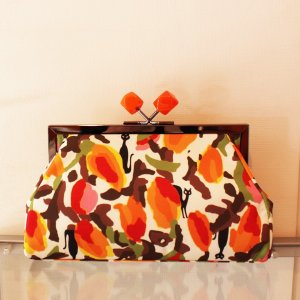 かわいいプリント クラッチバッグ がま口タイプ オレンジ|modisteclub