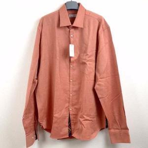 綿100%の厚手のオレンジ系生地をベースに、ボタンのラインや袖口の裏、両脇の裾の一部に渋目の色合いの...