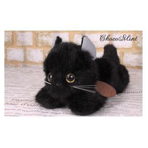 幼い顔立ちの黒猫がペタッと這いポーズしているヌイグルミです。  丁寧に製作された日本製です。  床か...