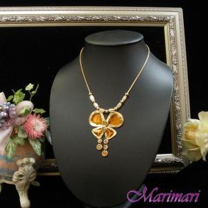 ◆【琥珀色の蝶ちょネックレス】飴色のミラースワロ☆[お揃いになるピアスがあるネックレス] ゴールド色台