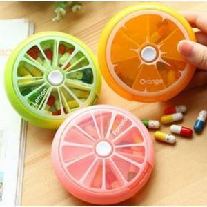 果物 デザイン の 丸形 ピルケース 7日分 で分けられる ピルケース 真ん中のボタンを押すと内ケー...