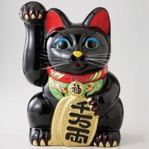 開店祝いや御祝い事の贈り物におすすめの右手をあげた黒い招き猫です。 より多くのお金を招くよう、手が長...