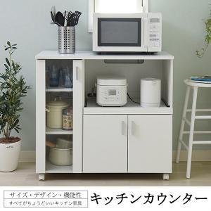 キッチンカウンター レンジ台 食器棚の写真