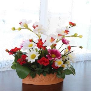 素焼きの花器に入った胡蝶蘭やデージーのアレンジ 造花 CT触媒 silkflower