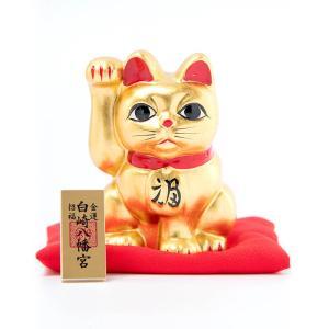 右手を挙げている猫は金運を招き、左手を挙げている猫は人(客)を招くとされています。 この純金箔の招き...