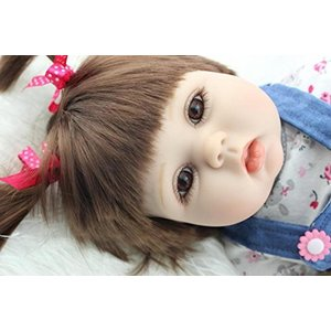 She is a cute fat-face toddler girl with Pigtails....