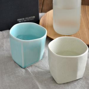 商品説明   涼しげなブルーと粉引のカップのペアセット。 石を削ったような複雑な形と爽やかな色が食卓...