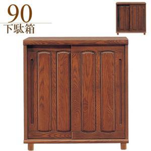 アッシュ材を採用した和風下駄箱です。戸の開閉に場所をとらない引き戸タイプ。湿気のこもりにくい脚付き仕...