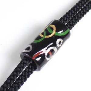 伊万里焼有田焼で知られる陶芸磁器ループタイ。黒釉金彩。|tatikawa