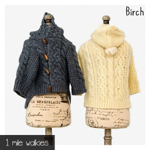 柔らかさとしっとりとした滑らかさを持つアルパカ混の毛糸で様々なアラン模様を編み込んだカーディガン。 ...