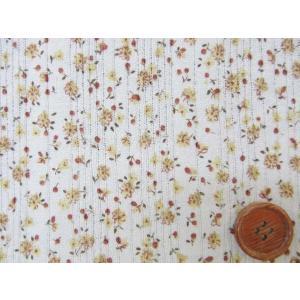 値下げしました。巾134cm 針抜裏毛ニット 小花柄 (黄色の花/生成り地)|tomoya