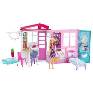 バービーと一緒にかわいいピンクのプールハウスで遊ぼう!セットにはバービーも含まれています。カラフルな...
