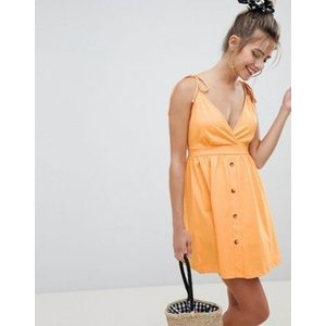 エイソス ドレス ワンピース レディース  ASOS DESIGN mini tie strap button through sundress オレンジ|trendcruising