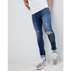 エイソス スーパー スキニー ジーンズ メンズ  ブルー ASOS DESIGN extreme super skinny jeans in dark wash blue with rips and embroidery|trendcruising