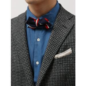 スーツに使用する生地を採用した蝶ネクタイ。MADE IN JAPANならではの丁寧な縫製技術にも注目...