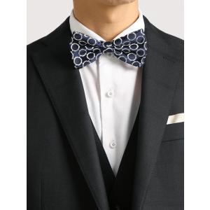 イタリア製の素材を使い、日本にて縫製した秀逸な蝶ネクタイ。サークル型のパターン柄と、小花のような小紋...