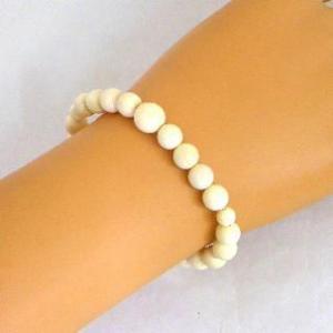 郵便発送可|パワーストーンブレスレット*数珠◆マンモスの牙◆主玉8ミリ|waraku-store