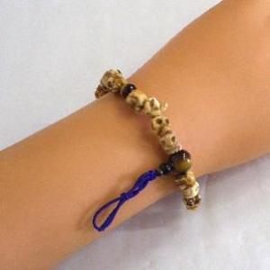 郵便発送可|パワーストーン*腕輪数珠◆牛骨ドクロ・虎目◆髑髏*御守|waraku-store