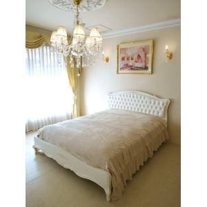 お客様のご希望によりラタン張りで好評なプリマベーラのベッドにフェイクレザーを張り込みボタン締めで仕上...