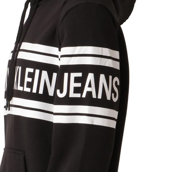 【即納】カルバンクライン Calvin Klein メンズ パーカー トップス VARSITY TRAVELLING LOGOCROSSOVER HOODIE BLACK - REBUY プルオーバー フード フーディ|ef-3|05