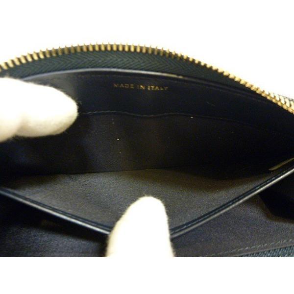【中古】シャネル ラウンドファスナー長財布 カメリア型押し グレインドカーフスキン ネイビー A703207