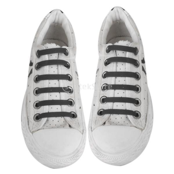 ノーネクタイ弾性シリコーン靴ひもがキャンバススニーカーをひもない2組の子供たち