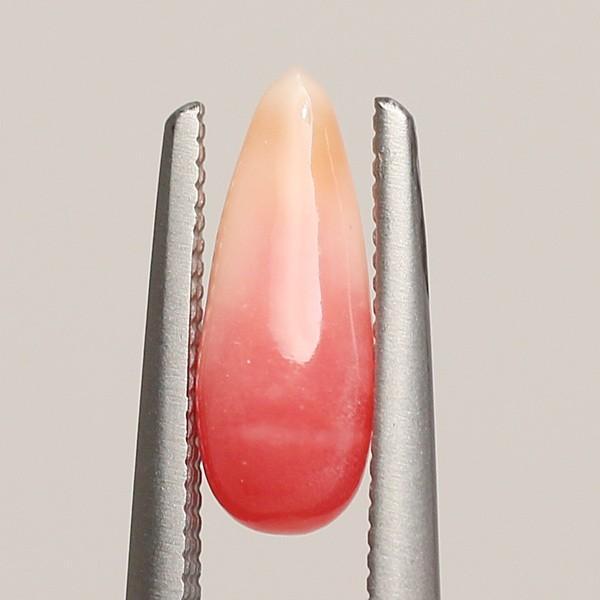 コンクパールルース0.89ct細長いバロック形色むら少し火炎模様約10.4×3.9×3.3mm|wizem