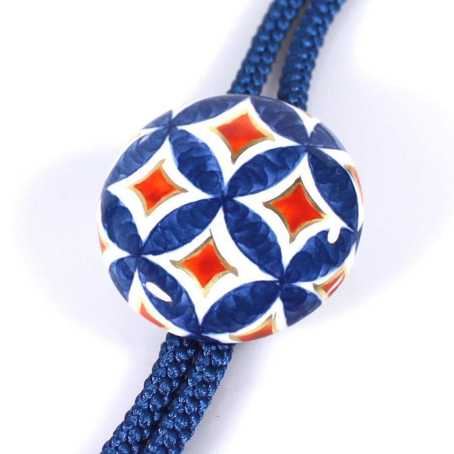 有田焼伊万里焼で知られる陶芸磁器ループタイ。染錦七宝紋様。|tatikawa