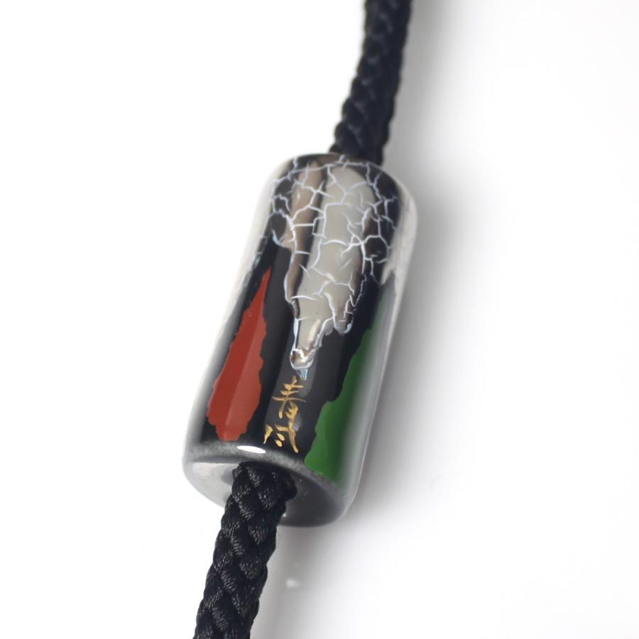 伊万里焼有田焼で知られる陶芸磁器ループタイ。黒釉白金彩貫入。 tatikawa 03
