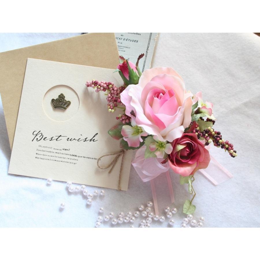 ピンクの流れるようなラインのバラのコサージュ|vertpalette-store
