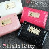 ・とってもかわいい♪キティちゃんのエナメル調型押しL字ファスナー二つ折り財布です。 ・エナメル調の素...